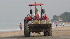 Tractor with rubbish on beach,Kuta,Bali,Indonesia Stock Footage