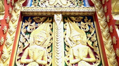 Close-up art on the wooden gate of Thailand Buddhist temple, slow motion Stock Footage