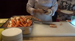 A chief cutting the crab legs,buffet dinner,in a hotel,China Stock Footage