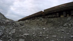 Railway carriages drove up to the place of loading of iron ore and stop. - stock footage