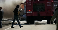 4K Footage Firefighter damp Burning Bus on the Highway Stock Footage