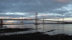 Forth Road Bridge and Queensferry Crossing at dawn Scotland Stock Footage