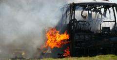 4K Stock Footage Exploded Bus Burns Stock Footage