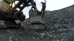 Multi-ton tracked excavator travels with a screech. - stock footage