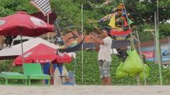 Kite seller on the beach,Kuta,Bali,Indonesia Stock Footage