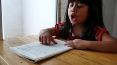 Girl working on math worksheet 4k Stock Footage