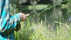 4K The hands of a man and young boy spending time together fishing - stock footage