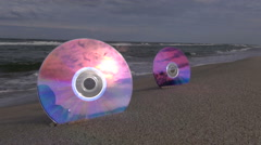 Seascape with 2 DVDs in resort beach sand Stock Footage