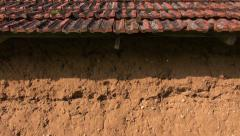 Sunlit reddish clay barn wall of an old building Stock Footage