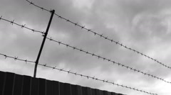 Timelapse of barbed wire against sky - stock footage