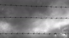 Timelapse of barbed wire against sky Stock Footage