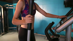 Woman exercise velosimulator in the gym Stock Footage