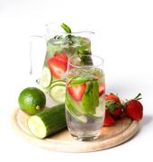 Flavored drinking water on the table - stock photo