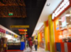 Abstract blurred image of a shopping center with a showcase retail stores - stock photo