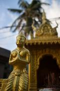 Close up of a Golden Figure on a House Shrine in Southeast Asia Stock Photos