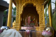 Burnt out Incense stick on a House Shrine in Southeast Asia Stock Photos