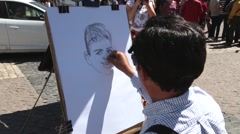 Caricature artist - stock footage