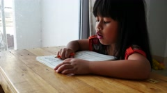 Asian little girl working on math worksheet 4k Stock Footage