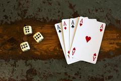 cards '4 aces' and dice - stock photo