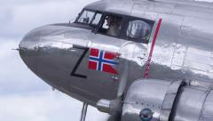 Douglas DC-3 close view cockpit engine turn tilt downwards wheels Stock Footage