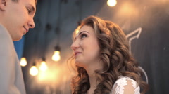 couple in love on the background of lights bulb - stock footage