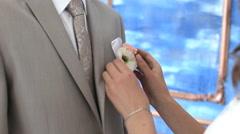 Bride groom straightens boutonniere Stock Footage