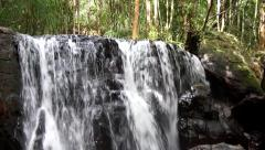 Close up high resolution footage of waterfall located in tropical rain forest - stock footage