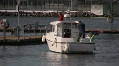 Motor cruiser in harbor with people on board Stock Footage