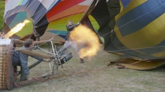 A ground crew works to get their hot air balloon inflated befor the flight durin Stock Footage