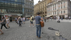 Playing a yellow guitar in Wenceslas Square, Prague Stock Footage