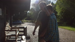 4K Man and young boy at fishing lodge, weighing their catch at end of the day - stock footage