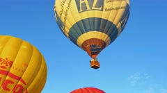 Multicolored hot air balloon flies into the sky at the Hot Air Balloon Festival Stock Footage
