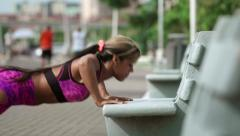 Woman Training Pectorals Doing Pushups On Street Bench Stock Footage