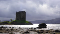 Castle Stalker in Scotland on a stoprmy day. Stock Footage