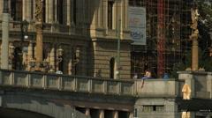 Girl sitting on Manes Bridge's railings in Prague Stock Footage