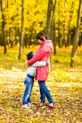 Mother and little son in park or forest. Hugging together Stock Photos