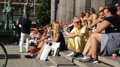 People at Hörtoget in Stockholm in Summer sunshine Stock Footage