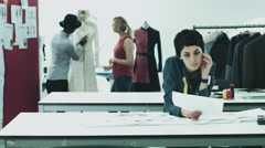 Fashion designers at work in studio - stock footage