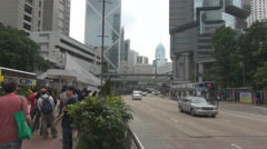 Traffic street Hong Kong downtown multiple lane people travel asian commuter day Stock Footage