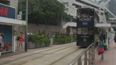 Busy tramway station Hong Kong downtown people commute crowded metropolis day Stock Footage
