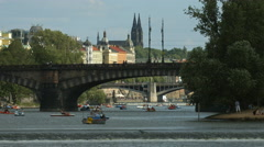 Little boats near Legion Bridge in Prague Stock Footage