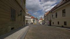 Walking near the old buildings of Loreta and Hradčanské Squares, Prague Stock Footage