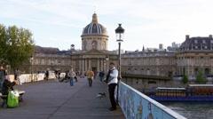 Paris, musician plays accordeon on Pont des Arts Stock Footage