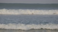 Surf in sea with drifting surfer,Kuta,Bali,Indonesia Stock Footage