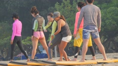 Surf instructor and students on beach,Kuta,Bali,Indonesia Stock Footage
