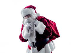 santa claus Hushing silhouette isolated - stock photo
