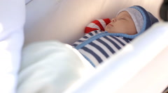 baby child in stroller cradle - stock footage