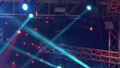 4k Stage lights on concert. Lighting equipment with multi-colored beams - stock footage