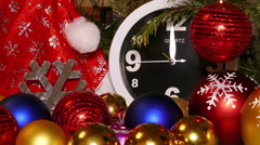 Clock and christmas balls and toys in a red bag Stock Footage