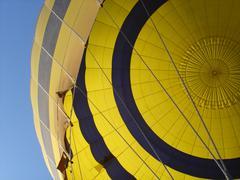 Yellow hot air balloon with blue sky Stock Photos